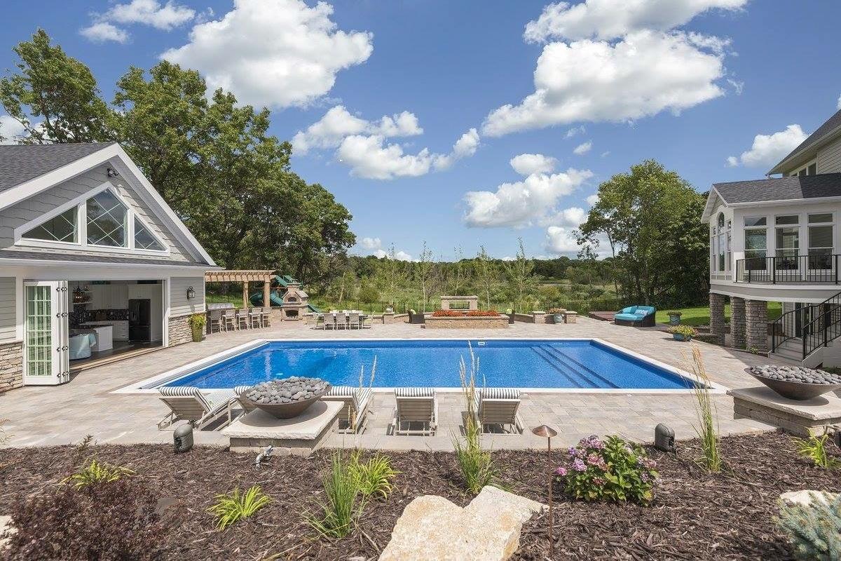 Beautiful custom backyard landscape design featuring a pool.